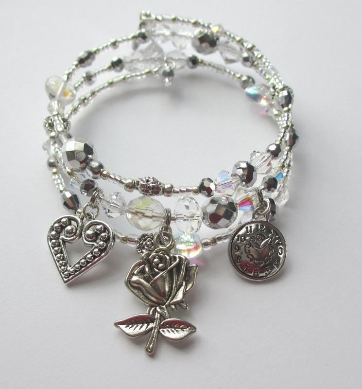 Sparkling clear and silver beads and crystals evoke the custom of the Knight of the Rose.