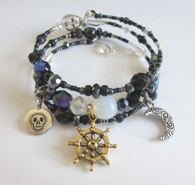 Black luster beads evoke the mystery of fate and fortune.