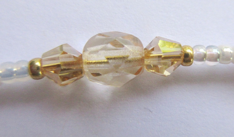 Pale golden beads and crystals symbolize the golden West.