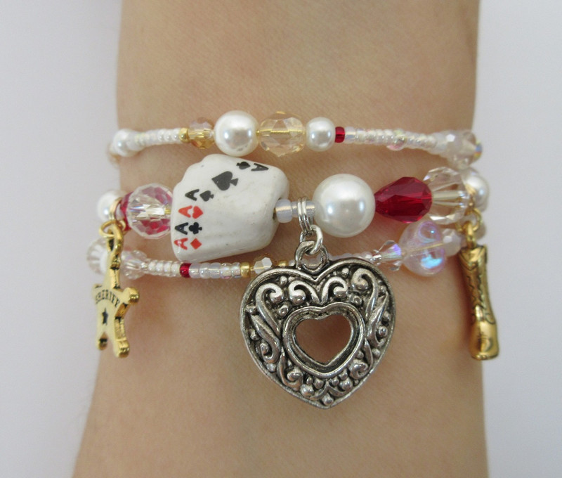 The playing card bead evokes the card game in which Minnie wins Johnson's life.