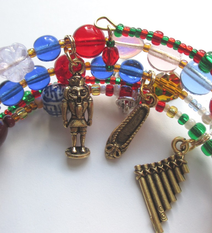 The Nutcracker Bracelet details: Nutcracker, Clara's slipper and toy flute.