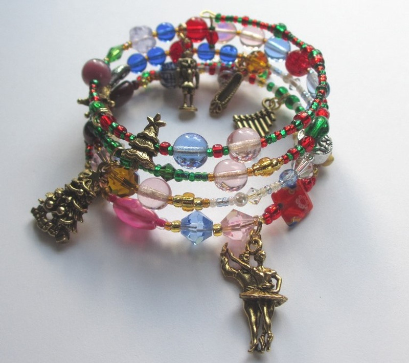 Symbolic beads and elegant charms tell the story of the holiday ballet the Nutcracker by Tchaikovsky.