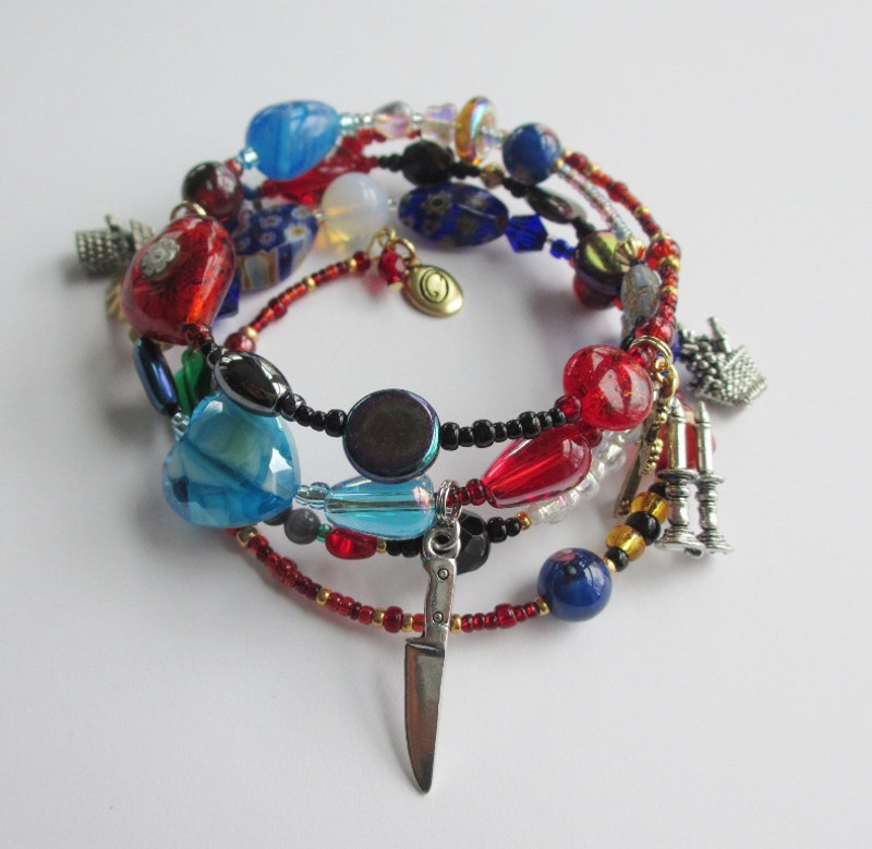 Another view of the Tosca Opera Bracelet, telling the story of the Puccini opera with symbolic beads and charms.