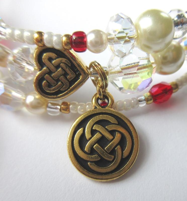 The Celtic knot charm evokes the setting of Scotland.
