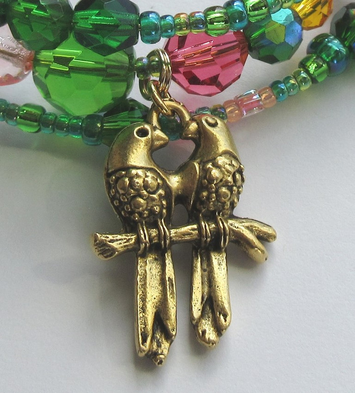 Lovebirds symbolize Papageno and Papagena.