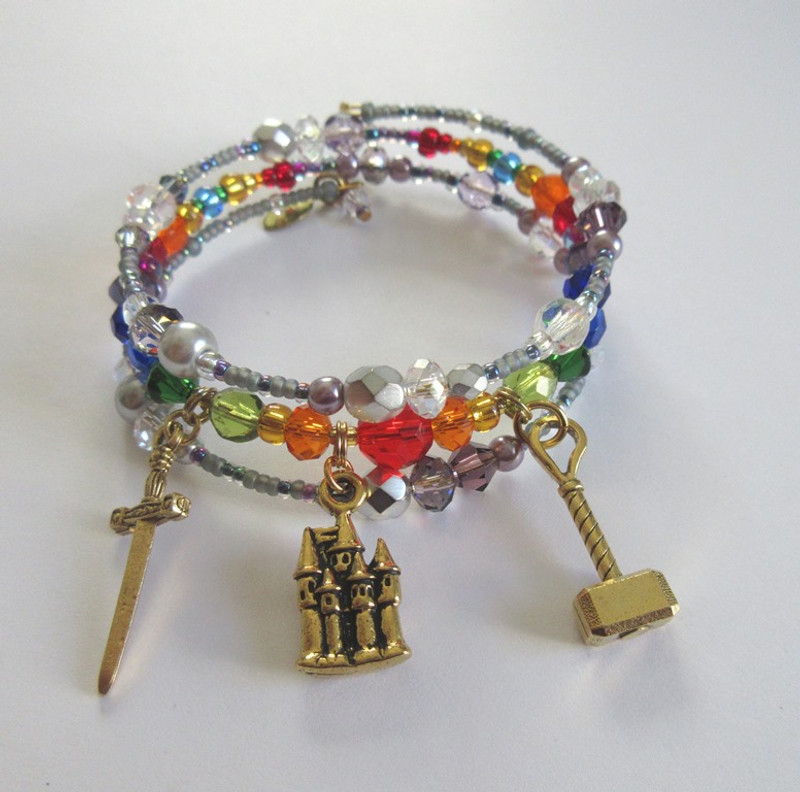 Storm colored beads frame rainbow colored faceted beads and crystals to symbolize the Rainbow Bridge to Valhalla.