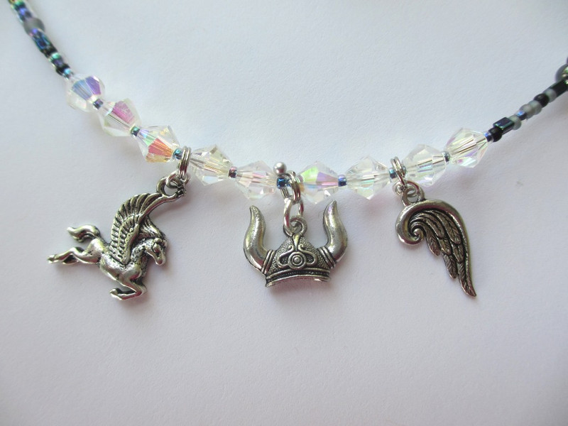 Aurora Borealis beads represent the Valkyries' mythological identity as creators of the Northern Lights.
