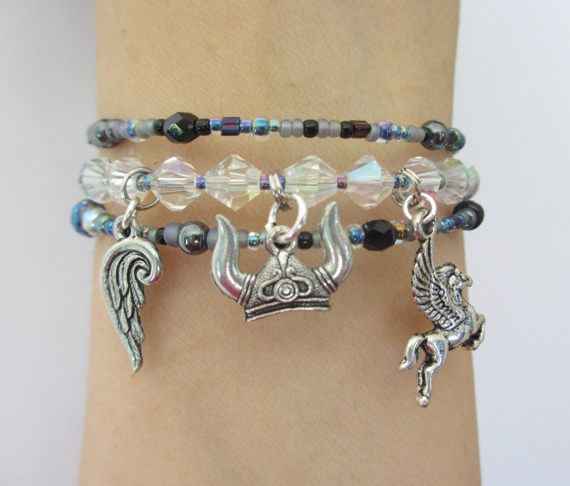 Helmet; wing and winged horse charms symbolize the Valkyrie's divinity and power of flight.