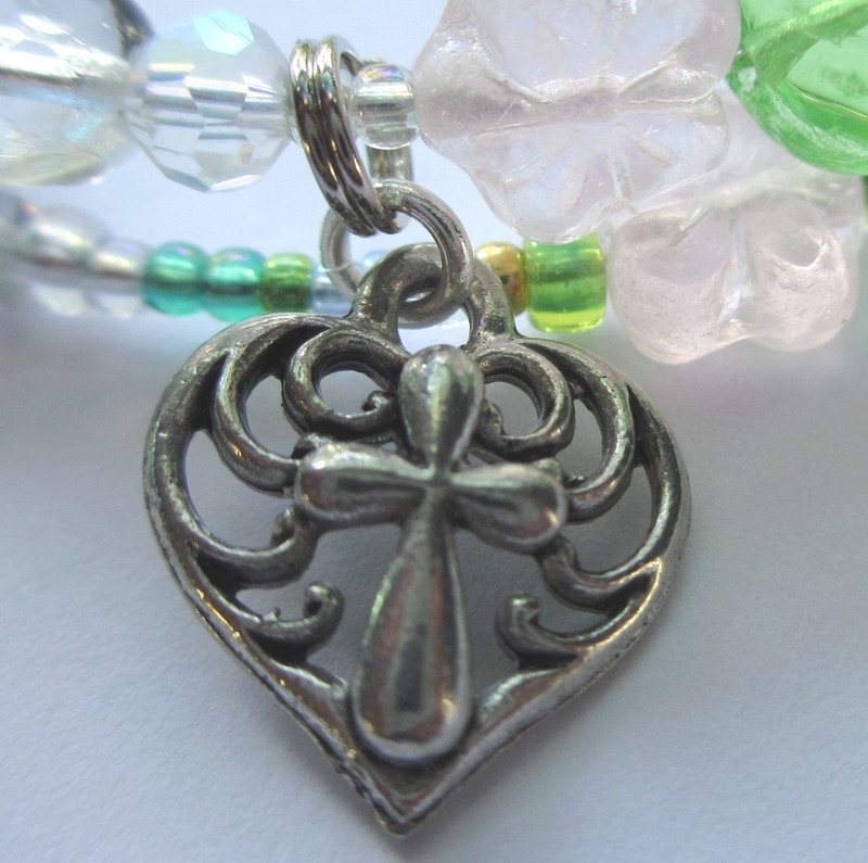 The cross-in -heart symbolizes Siebel's love and faith.