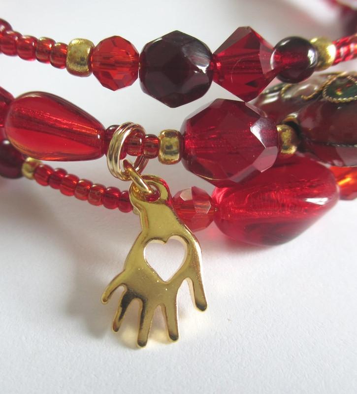 "The hand in heart charm evokes the aria ""O dolci mani."