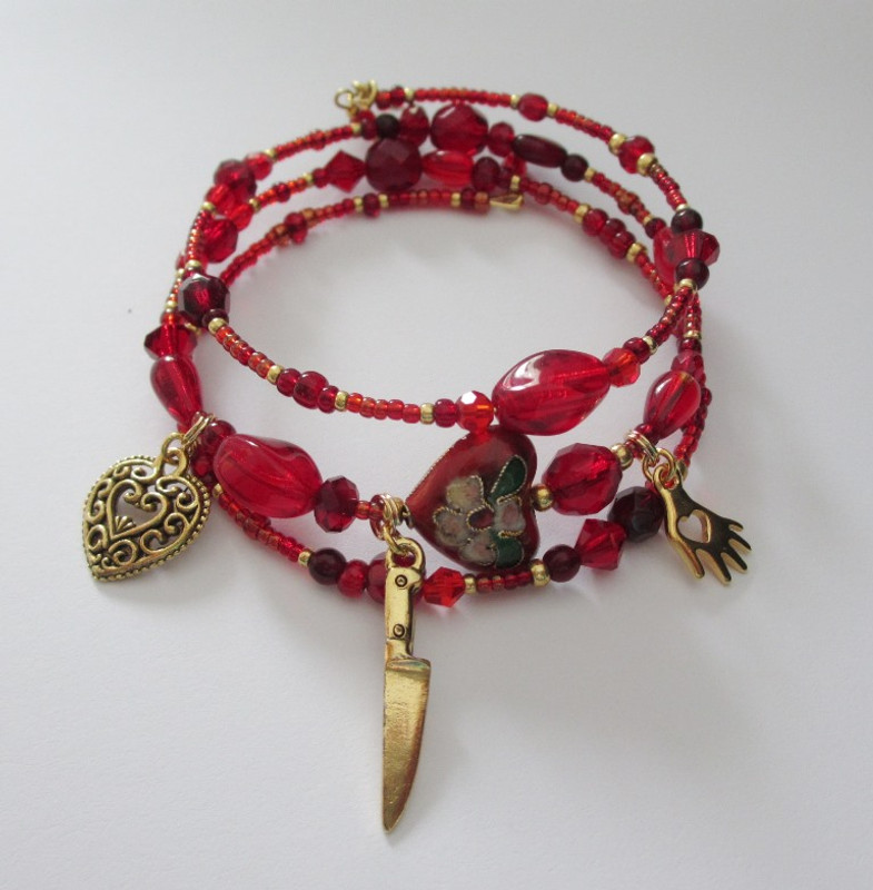 Beads and charms symbolize Tosca's passion, love and desperate actions.