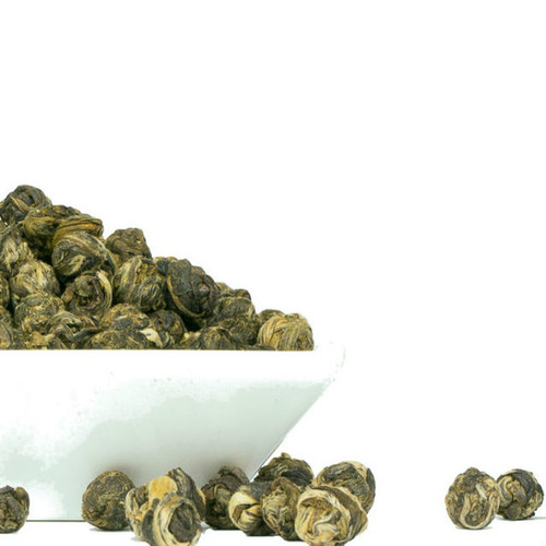 Our Jasmine Pearls are hand-rolled jewels from Fuding, in Fujian province, China. Any fan of jasmine tea should try this specially crafted wonder. When added to hot water, the pearl majestically unfurls, releasing their delicate scent and flavor. Also, known as Jasmine Dragon Pearls, their liquor is sweet and almost sugary with a very soft and airy mouthfeel. The delicate quality of the flavor is due in part to the leaves used to produce this tea: two tender, tiny new leaves and one plump unopened leaf bud. Steep: 1 Pearl to 1 oz water, 175 degrees-185 degrees, 2-3 Minutes