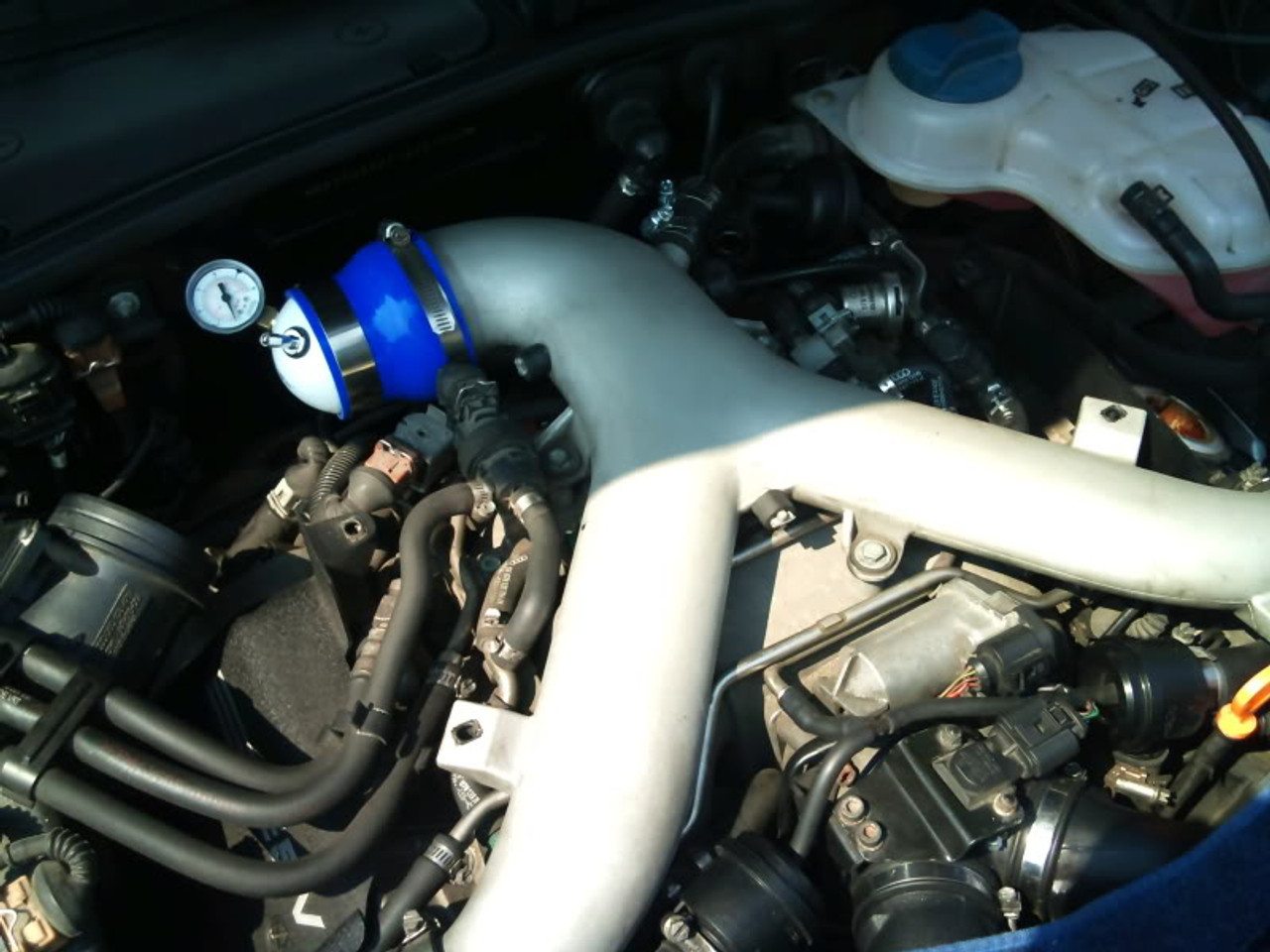 Attach boost leak tester at the y-pipe inlet as shown.