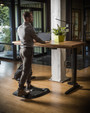 Topo at a standing desk