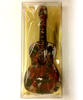 Package of hand-painted acoustic guitars by Ü Chocolate for the World