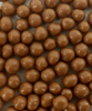 Close up view of Belgian Milk Chocolate Salted Caramel Caviar by Ü Chocolate for the World