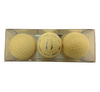 Boxed white chocolate golf balls.