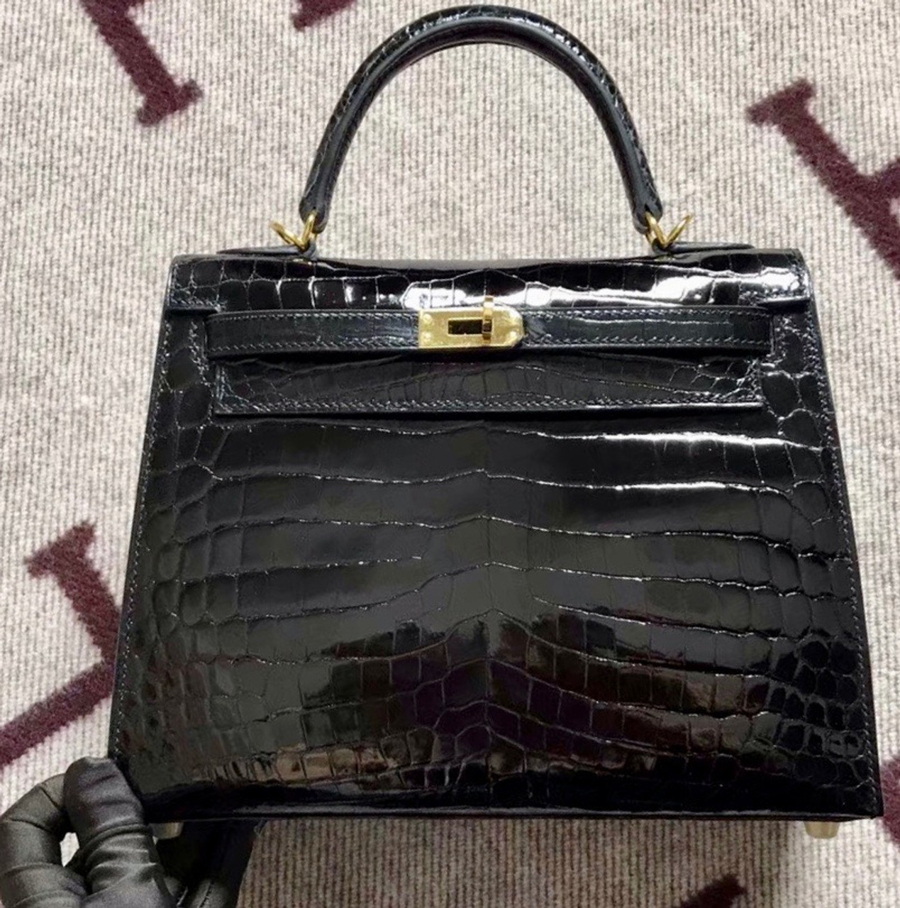 0c010d1433 ... greece hermes shiny black niloticus crocodile kelly 25 with gold  hardware e87cc 6a735