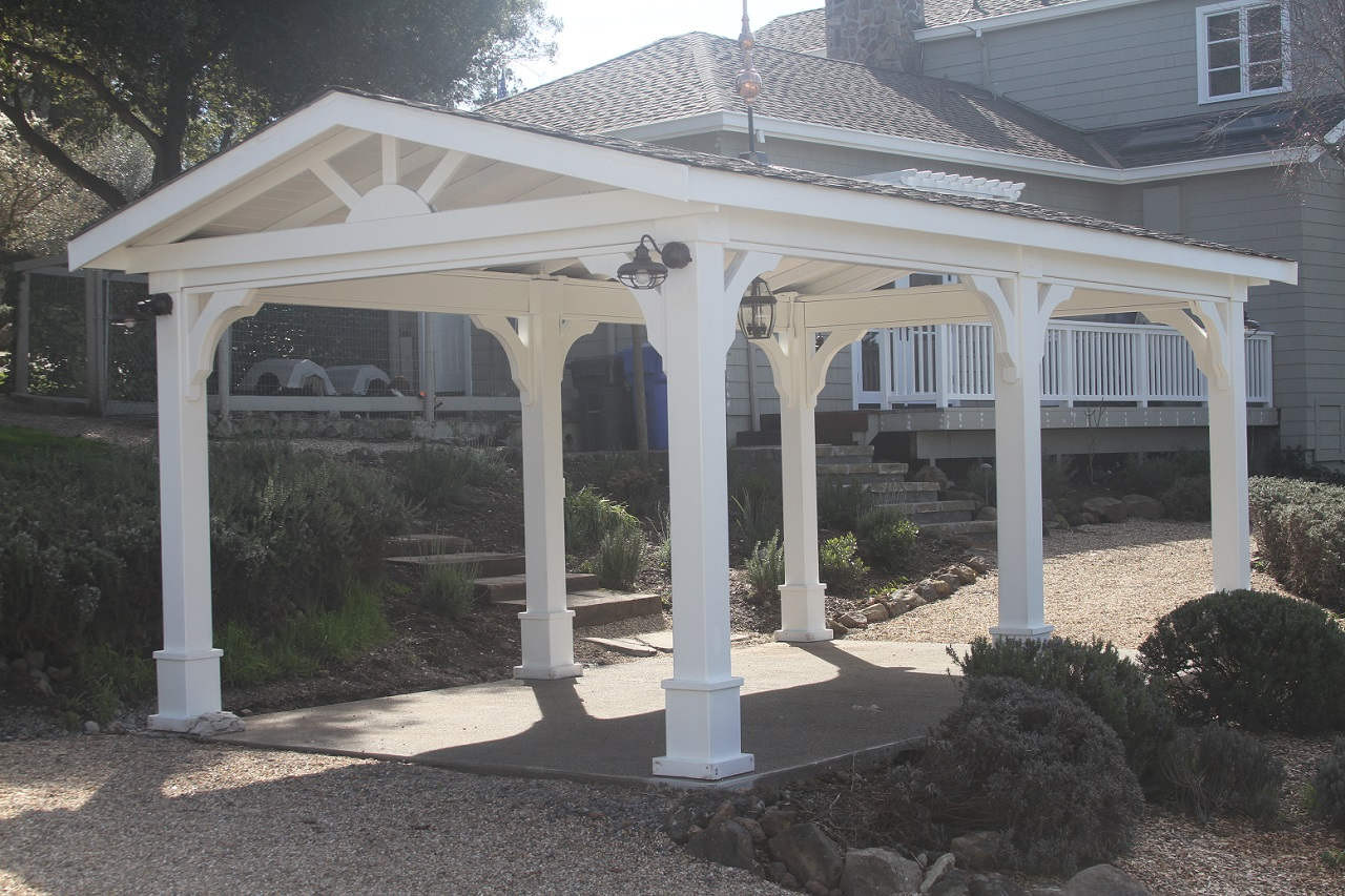 "12x20 pressure treated pine patio cover kit. Options include white paint, shallow pitch gable roof (3:12 pitch), 7"" square posts, Rustic Redwood asphalt shingles. Napa, CA."