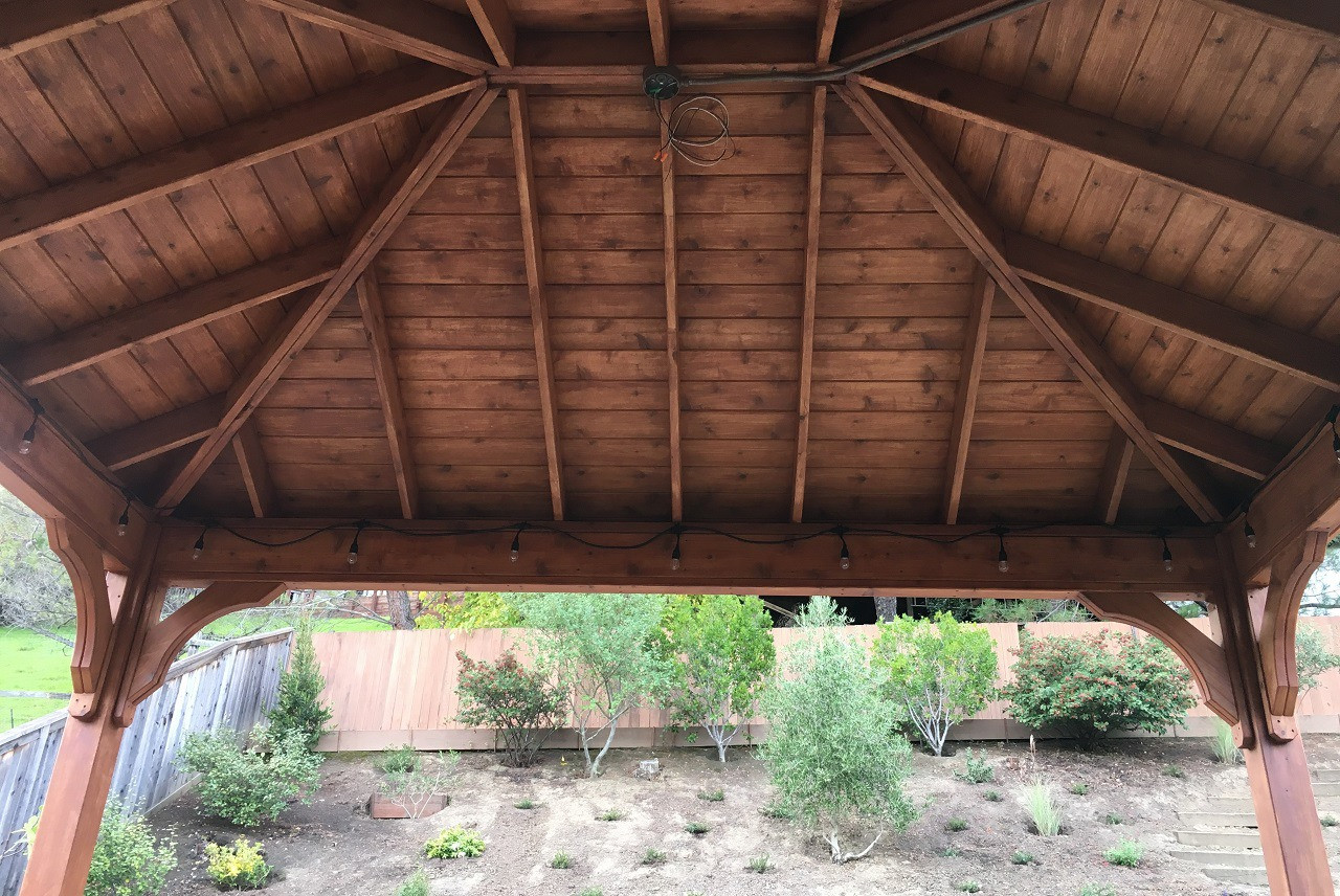 """14-3"""" x 11'-0"""" roof span Red Cedar Pavilion - Traditional Roof / 6""""x6"""" sq. columns extended length / Electrical kit / Heavy Duty Anchors / Black roof shingles / Sealant/stain combo by Sikkens #77 Red Cedar / San Rafael, CA."""