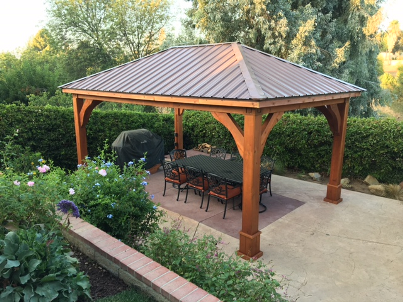 12x18 roof span pavilion / Traditional Roof design / Western Red Cedar/ 8x8 columns / Grand Cedar style corner braces / Brown Metal Roof option / Cedar color stain & sealant / Electrical Package / Simi Valley, CA