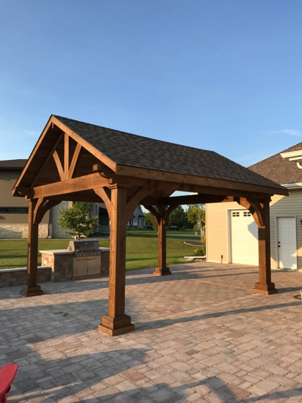 """14x16 (outside post dimension) Grand Cedar Pavilion, Roof Span 16'-8"""" x 18'-0"""", Rough Sawn Western Red Cedar, Walnut Stain, Weathered Wood roof shingles, electrical trim kit, Tongue & Groove Ceiling, Posts 1ft taller. Grand Forks, North Dakota."""