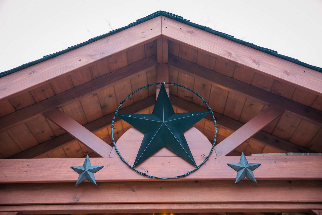 Sunburst design at open gable end, partially obscured by star decoration (star decoration not included)