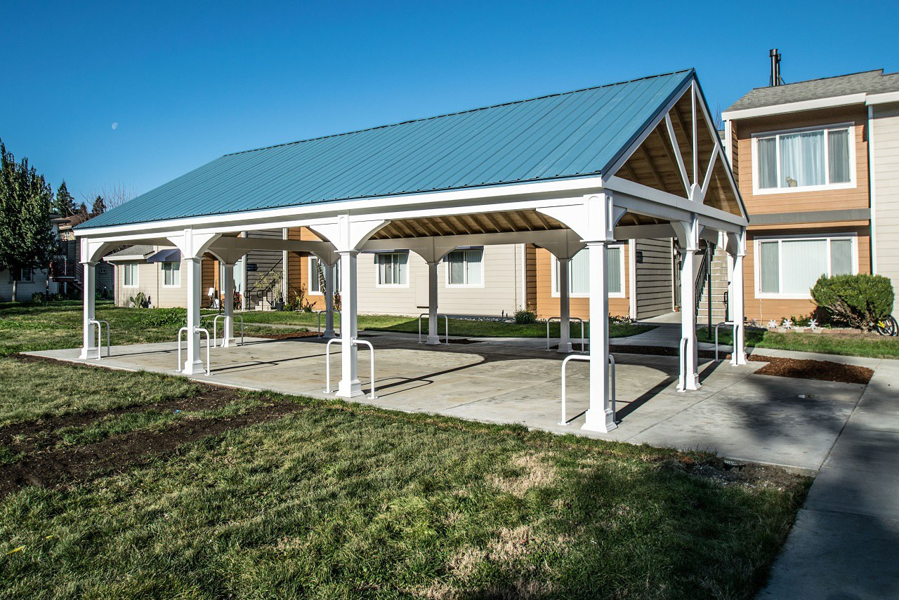 "36' x 24' Premium Vinyl Pavilion - Gabled Roof / Pressure treated pine wrapped in matte white 5/8"" thick exterior PVC trimboard / Blue metal roofing option / commercial installation at apartment complex in Winters, CA."