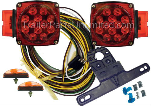 """Part No. J-20445-NCD LED Over 80"""" Submersible Clamshell Kit. Includes: Right Side Tail Lamp & Left Side Tail Lamp Two Marker Lamps. 25' Wire Harness. License Plate Bracket. Wire Connectors & Hardware. 14"""" Wiring Leads. Marine compatible."""