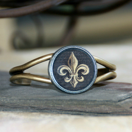 ART-121 Black and Gold Fleur de Lis Cuff Bracelet