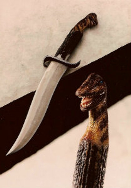 """""""Brachiosaur"""". From Paul Grussenmeyer's Jurassic Park inspired dinosaur series. Carved from a crown India Sambar stag handle mounted on a mastersmith James Porter forged damascus blade knife. Opal eyes with painted pupils, 9.13"""" damascus double-edged, S-shaped blade, 14.75"""" overall, curled guard. This was the first knife made with Jim's new mastersmith mark at the time."""