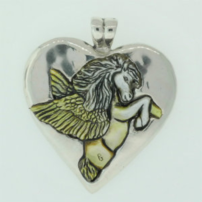 Carved gold lip pearl Pegasus mounted on a cast sterling sliver pendent with integral bail by Paul Grussenmeyer.
