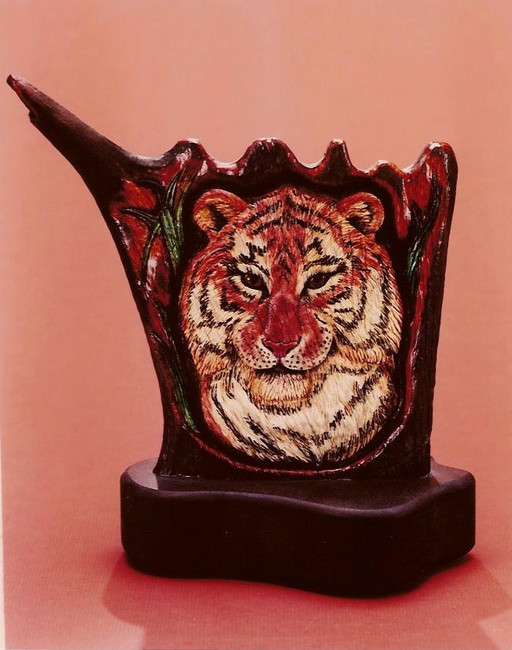 """""""Siberian Stare"""". Carved American Moose Antler lifelike sculpture by Paul Grussenmeyer. The palm part of the moose antler used for this sculpture of a Siberian tiger. Rhodolite garnet eyes were set and cut out from behind, then back filled with clear resin. It can be backlighted to make the eyes come alive. Heavy walnut base."""
