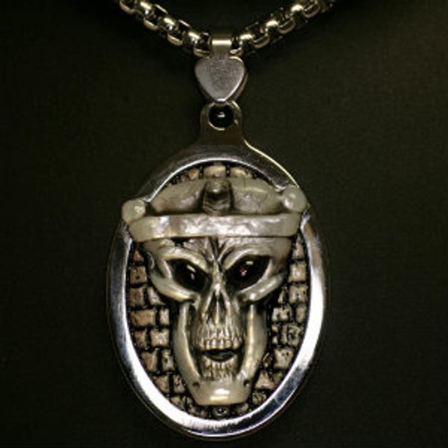 """Paul Grussenmeyer carved pearl and fossil Stellar's Sea Cow rib bone, Egyptian themed pendent and necklace, """"Pharaoh's Ghost"""".  Carving is mounted in a stainless steel pendent with a 24"""" stainless steel box chain necklace and lobster claw clasp. Rhodolite garnet eyes."""