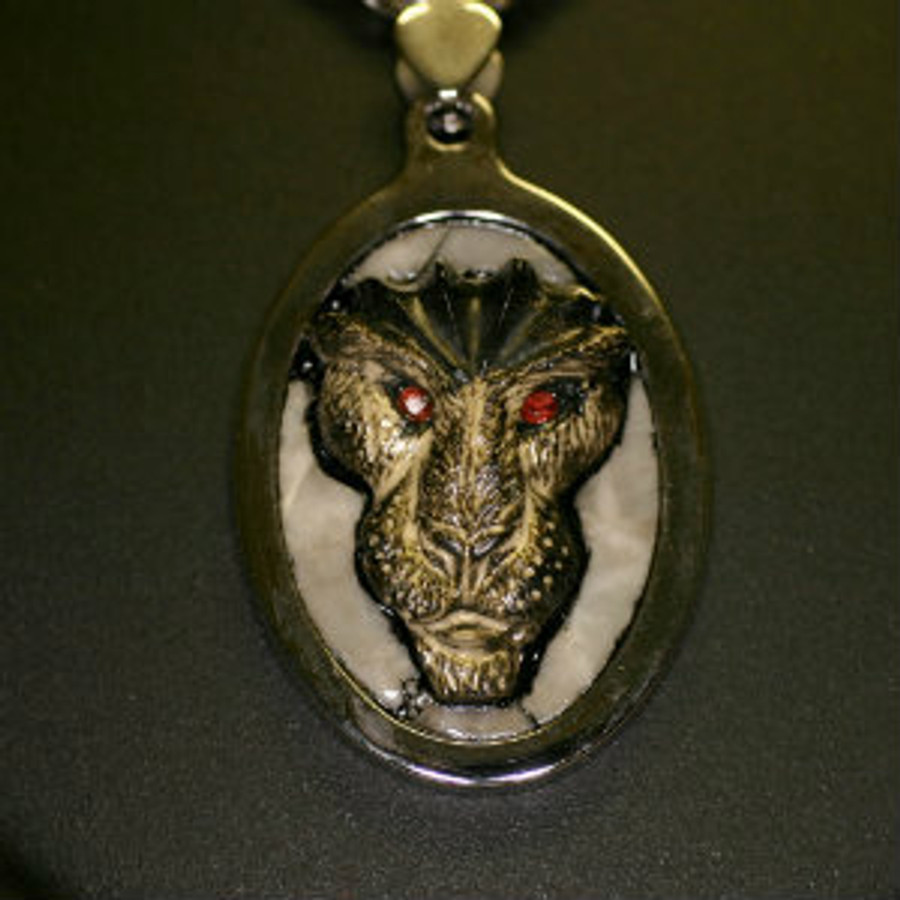"""Paul Grussenmeyer carved black marble Egyptian themed lion face with pieced gray marble background mounted in a stainless steel pendent, hung on a 24"""" stainless steel wheat chain necklace with toggle clasp."""