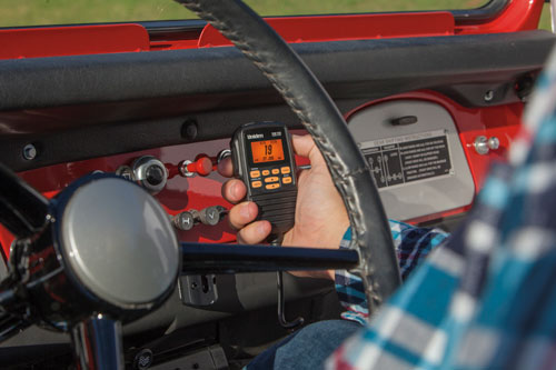 Two-way radio on dash of red vehicle