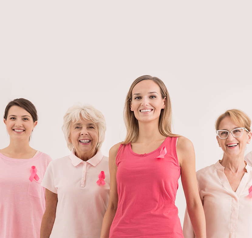 Ladies of all ages wearing pink and smiling