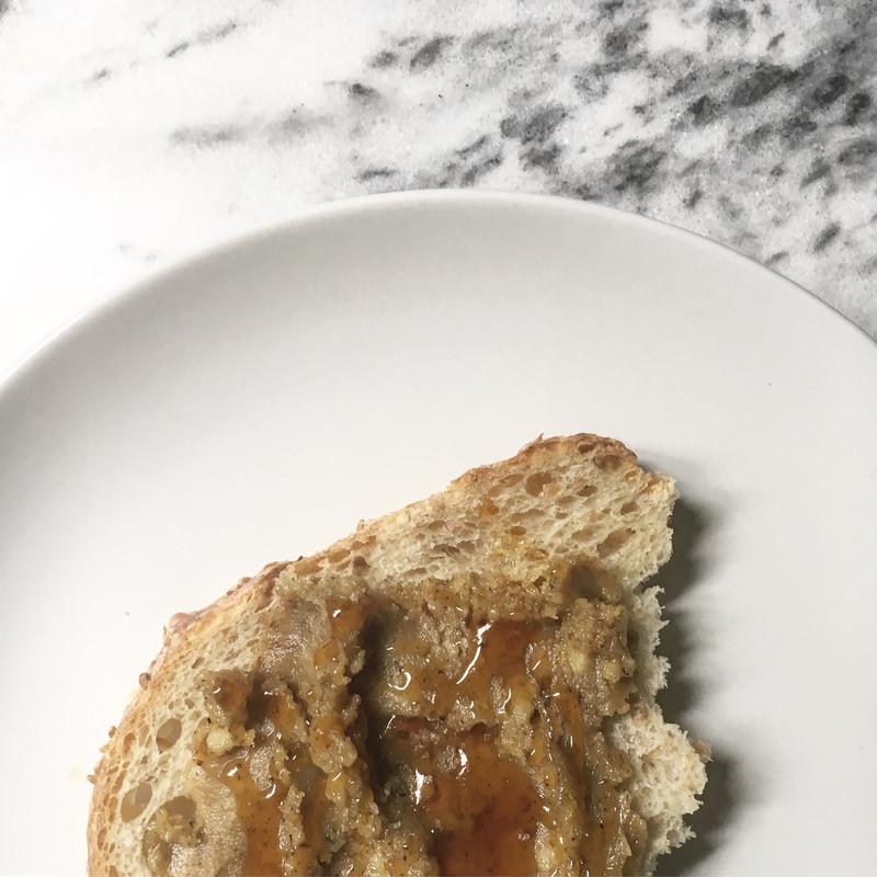 CORKY'S NUTS Raw Organic Walnut Butter on bread drizzled w/ honey