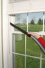 Cleaning window sill with crevice tool.