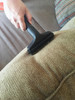 Cleaning couch with upholstery tool with slide on brush.