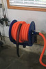 Hose reel mounted to a garage wall.