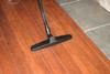 Floor brush tool cleaning hard wood floor.
