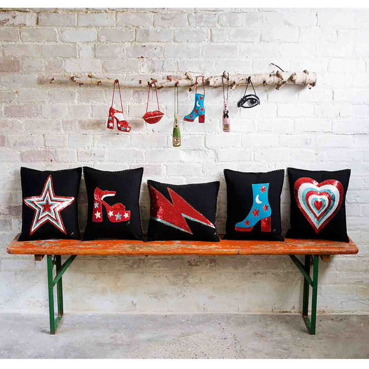 Black felt wool cushion with hand embroidered lightning bolt in red and blue sequins.