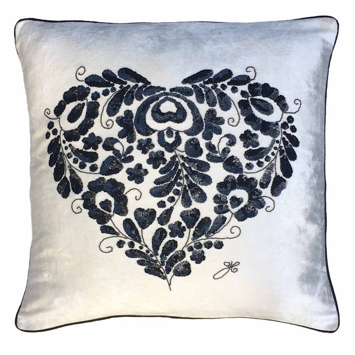 Cream velvet cushion with intricate hand embroidered Romany Heart in black sequins.