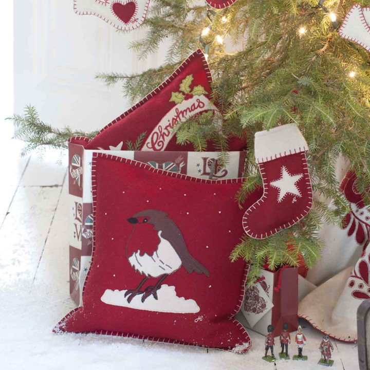 Hand-stitched Christmas Red Robin appliqué on red wool felt cushion.