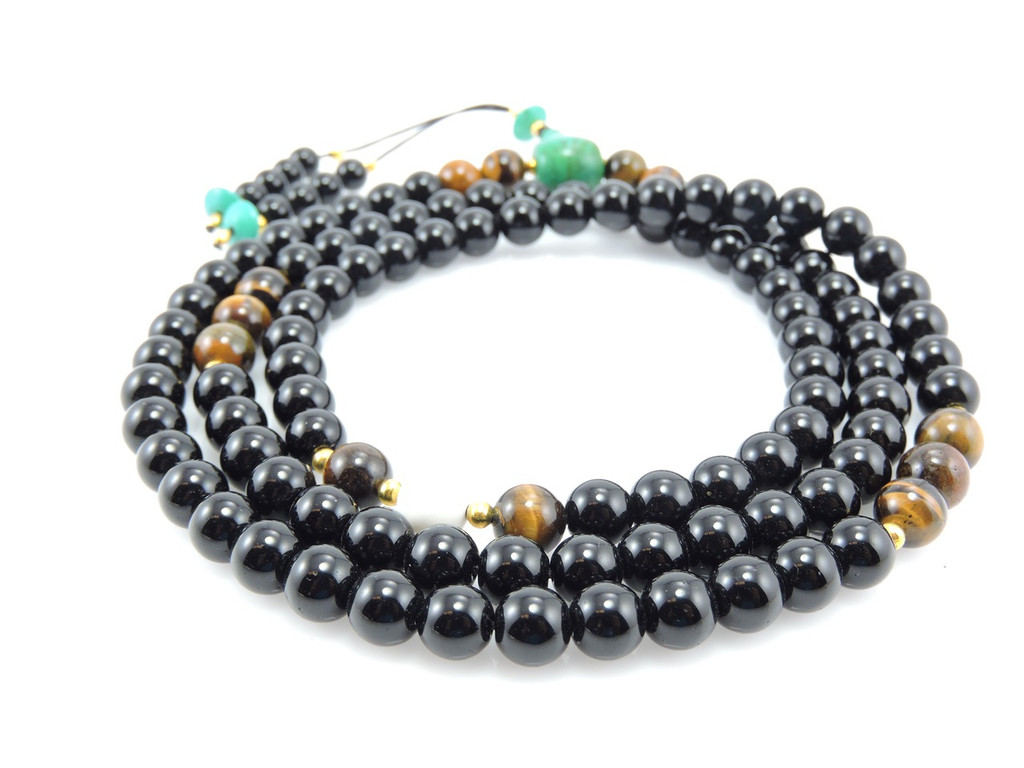 Austere Black Onyx with tiger eye and turquoise guru bead