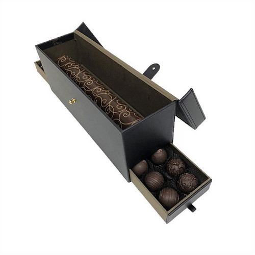 Leather Chocolate Gift Box - Open. Filled with Chocolate Jewels, Truffles, and a Chocolate Log.