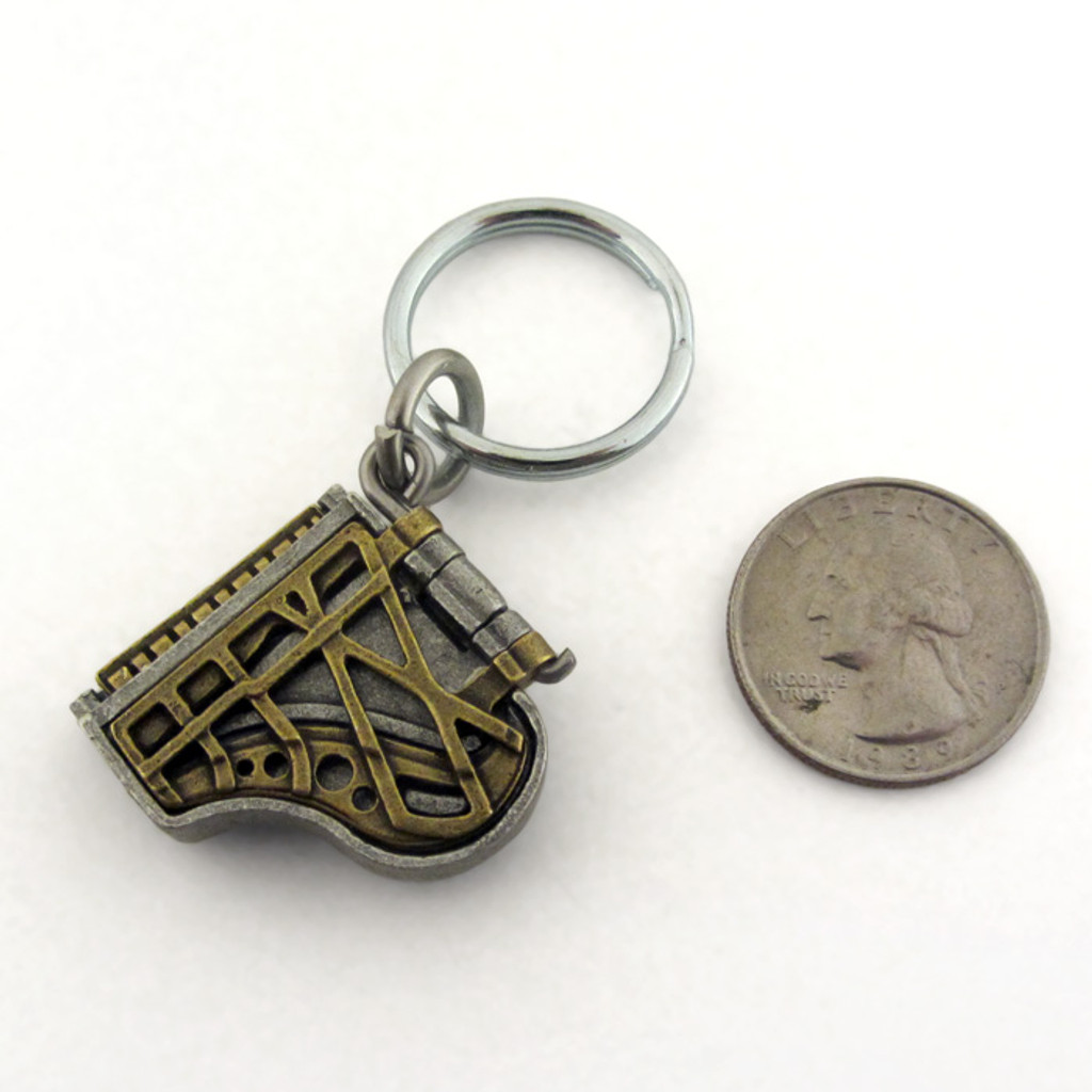 grand piano locket keychain option with US quarter for scale