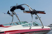 Optional wakeboard tower racks can hold wakeboard, kneeboards, wakesurf boards and skiis