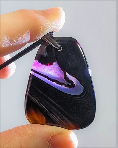 Black and Pink Agate Pendant/Bead Stone - backlit view